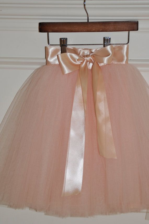 Blush Color in this picture,  this tutu skirt comes with a satin liner and a long ribbon to tie a bow and lots of soft tulle layers !  Great for photo shoots, weddings, ballet & birthday parties. This tulle skirt is machine sewn and has several layers of tulle that have been sewn together layer by layer on a wide double sided deluxe soft satin ribbon. Fully Lined This tutus are composed of lots of layers of completely all sewn soft tulle and closes at the back with two clasps.  At the wai...