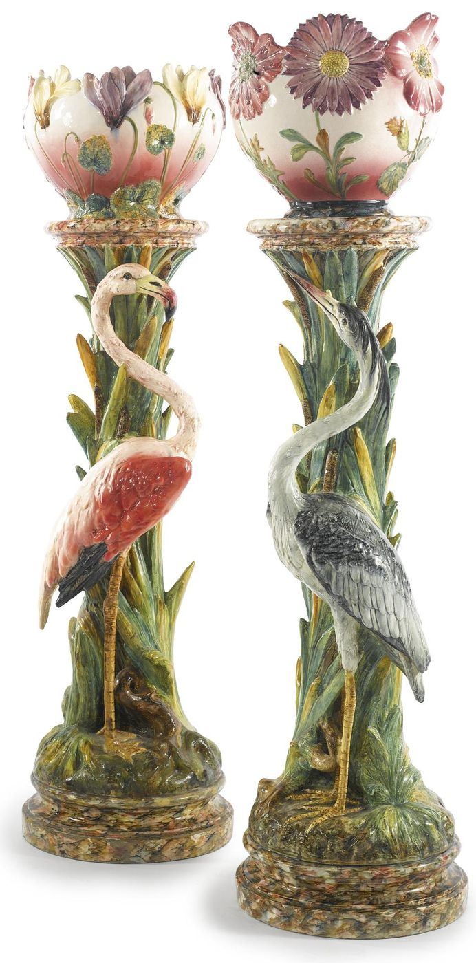 Two French majolica planters on tall heron and flamingo molded pedestals,Vallauris, France.