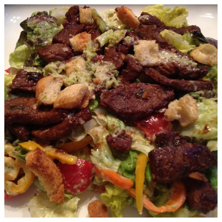 Spicy orange Asian style beef on red leaf lettuce salad with avocado, tomatoes, sweet peppers, scallions, homemade broccoli vinaigrette, and pita croutons.: Red Leaf, Leaf Lettuce, Asian Style, Red Leaves, Homemade Broccoli, Lettuce Salads, Broccoli Vinaigrette