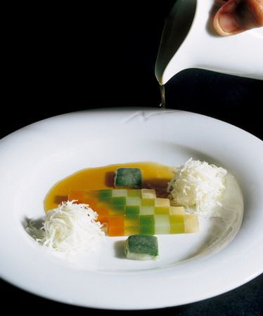 Hot vegetable jelly minestrone with fluffy parmesan truffles from elBulli, Ferran Adria.