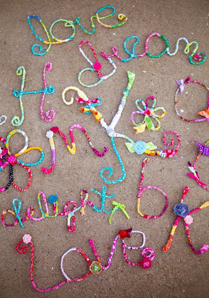 fabric covered wire bent to make words!! Great idea! Could work for any holiday, season or special occasion.