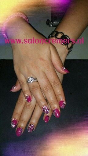 Pink nails with a lot of rhinestones bling nail art