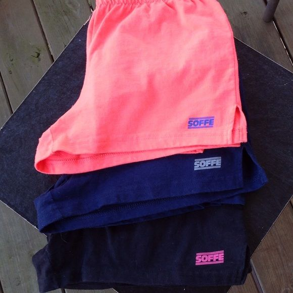 Soffe shorts cheerleading shorts Basically new worn once. Size medium. One black one navy one mango. All Preloved items have been worn. The amount of times worn varies.  If you are offended by signs of wear I.e. Pilling, or wash signs please do not bid on Preloved items. Buyer will not be granted refund for wear. If you have questions regarding this item please ask before purchase. Soffe Shorts