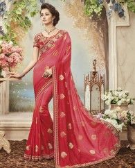 1. Red pure silk sari 2. Adorned with exclusive hand made cut work border 3. Comes with a matching embroidered art silk unstitched blouse