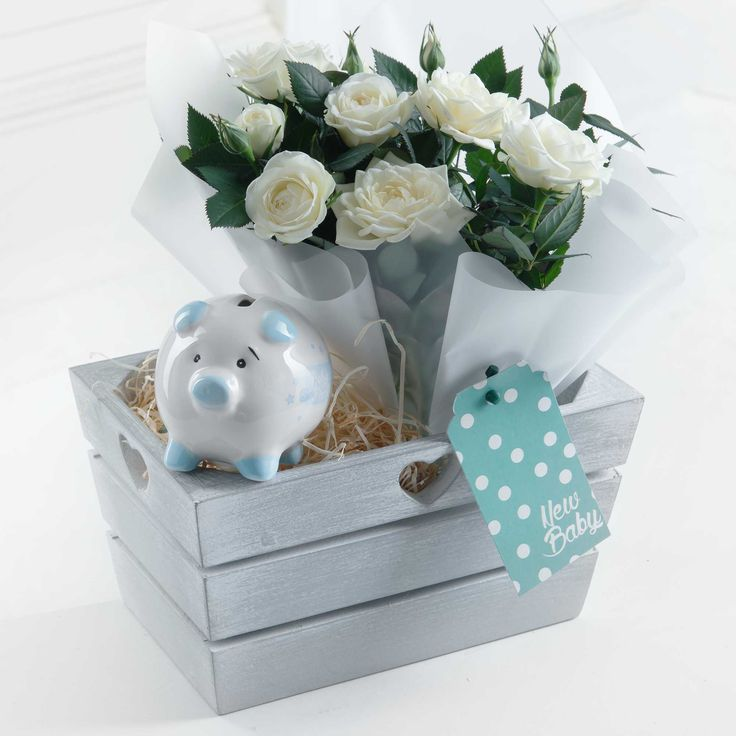 New Baby Boy Gift Set - Welcome the new bundle of joy into the world with this charming gift set. Featuring a blue piggy bank and beautiful white rose, this is a perfect way to say hello to the new baby.