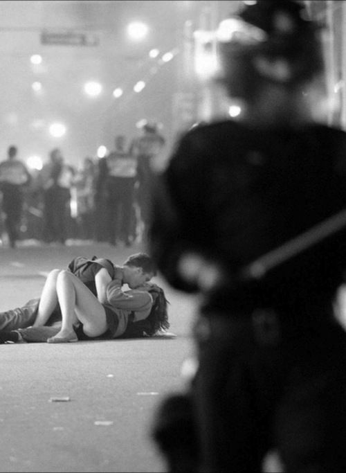 Favorite Canadian photo. Couple on the streets during Vancouver hockey riot.