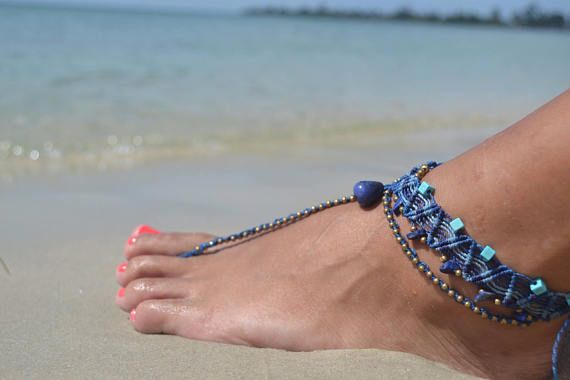 Sexy macrame barefoot Sandal in shades of blue, embellished with brass beads, sodalite chip beads, light blue beads and a Sodalite drop. Comfortable and lightweight goddess barefoot sandal. Add a pop of color and sexiness to your every step! This barefoot sandal is perfect to use by itself but its also totally comfortable to use with flip flops and flats.  In addition to looking amazing, this barefoot sandal carries a Sodalite stone, which has a strong vibration that will bring your…