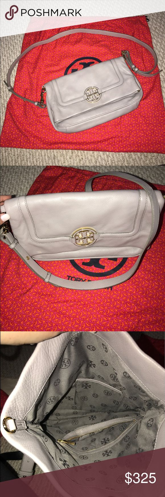 Amanda Foldover Crossbody bag Like new!! Purchased and used only a handful of times! Grey Tory Burch Amanda messenger or clutch bag. This grey leather and Gold hardware goes with everything! Flash and no flash pictures in listing. The leather is so soft. Nice sized for a cross body or Clutch 👛 Tory Burch Dust bag included! Tory Burch Bags Crossbody Bags