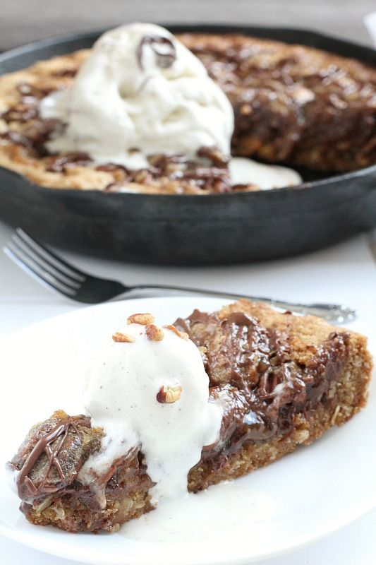 Chocolate Pecan Pie Skillet Cookie - peanut butter oatmeal cookie base topped with melted chocolate and pecan pie filling. An easy and delicious dessert perfect for any occasion!
