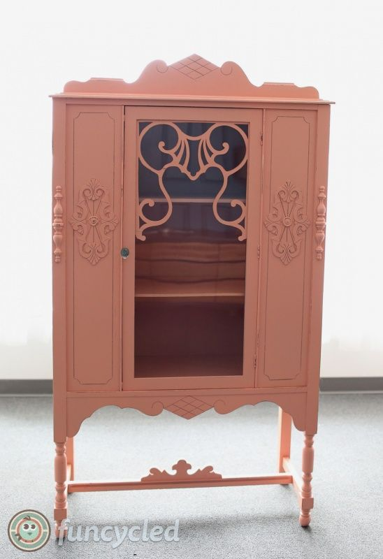 Antique china cabinet painted coral by FunCycled. Paint color is Ravishing Coral by @Shermanwilliams. www.funcycled.com