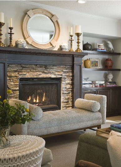 Who doesn't like to cuddle up in front of a toasty fire?? Add even more warmth to that already warm space by combining a wood mantel with stone.