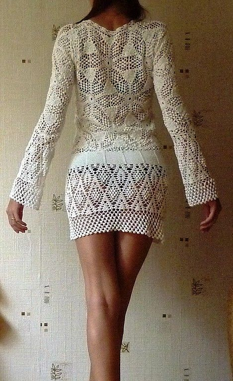 Crochet is a versatile art form. You can create sweaters and hats and toys and blankets. This dress might even be be a great fashion piece worn...if you were wearing something underneath. Leggings and tank top please? Who is seriously going to go out in public like this?