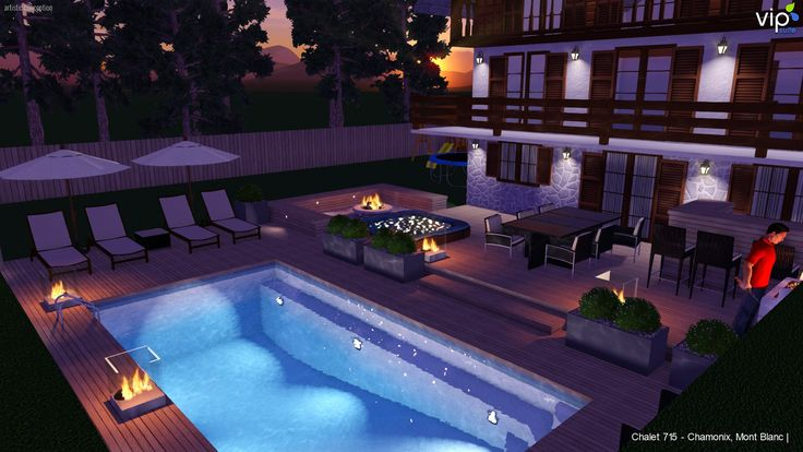 Alpine chalet outdoor entertaining deck & pool area at night