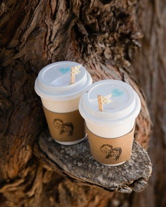 The folks at Big Sur Bakery, who catered the wedding, set up an after-dinner coffee and chai bar and stocked it with cups and custom sleeves the couple made using a portrait stamp from Lillimandrill.