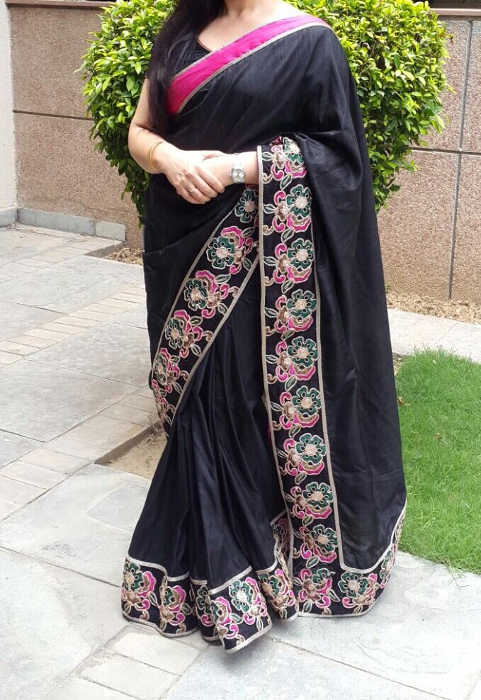 Black raw silk saree with pink and green floral border