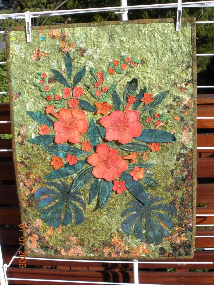 Hibiscus wall hanging from class at Be Creative By The Sea with Caroline Sharkey. This features fabric collage for the background, 3D flowers and leaves and free machine applique.