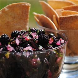 """Raspberry Salsa """"This salsa is sweet, tart and fresh, like a perfect summer day. Raspberries are blended with the vibrant flavors of jalapeno and cilantro to create a crowd pleasing topper for pork and other savory foods."""""""