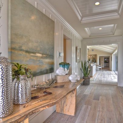 Coastal style with stunning architectural features gives this a cleaned up historical charm. Love the floors and the art sharing a color story!
