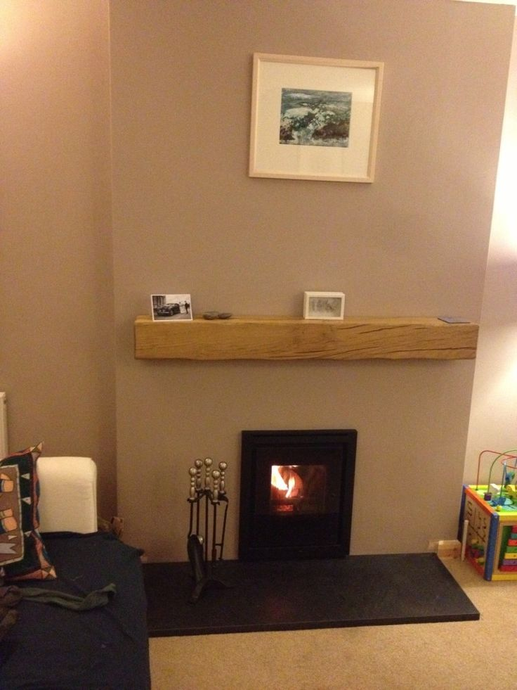 Inset wood burning stove installed with floating oak beam and granite hearth. Chimney lined.