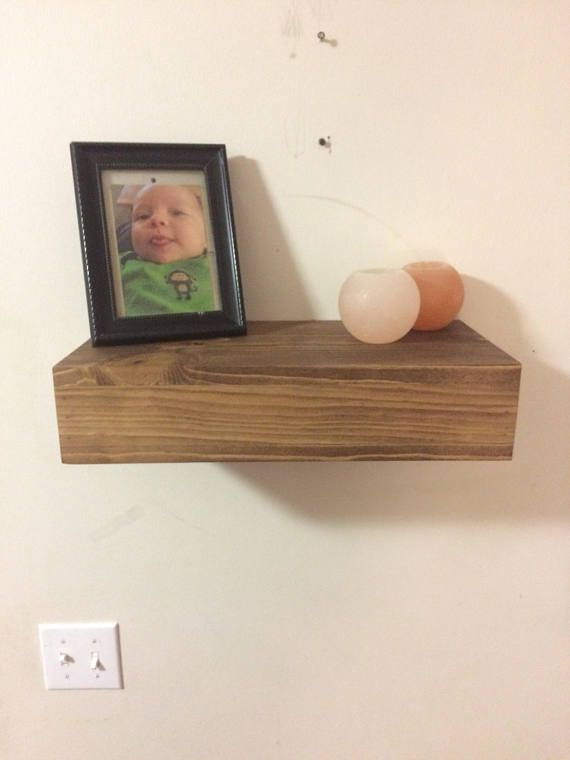 Need a place to hide your personal belongings while adding a rustic touch to your home? Look no further! Dimensions: Shelf: L: About 18 inches (featured in picture) W: 9 inches H: 4 inches Hidden compartment shelf: L: 14 3/4 inches W: 7 1/4 inches *Other size & stain options available- please see picture and select from drop down box* Want to see how our shelves work? Check out our YouTube video: https://m.youtube.com/watch?v=H7EIx5xJVdM (Shelves over 18 i...