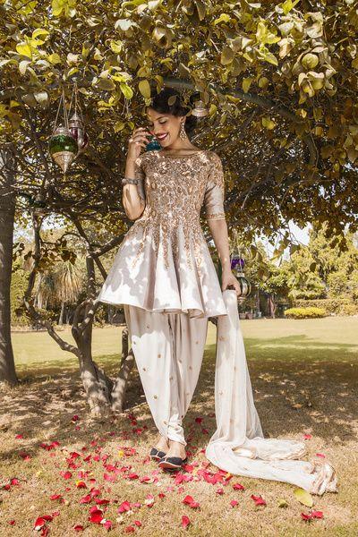 Mehendi Outfits - Peplum Style Embroidered Kurti with Salwar | WedMeGood  #wedmegood #indianbride #indianwedding #indianwomensuits #mehendioutfit #suit