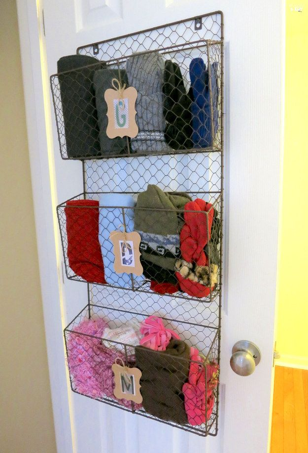 A magazine rack can make the back of your door do double duty. | 21 Useful Things That Will Actually Organize Your Closet