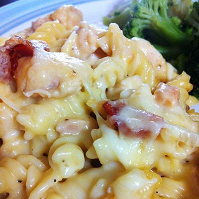 Cheesy bacon chicken casserole --  •4-5 boneless, skinless chicken breasts •6 strips of quality bacon – cooked and crumbled •2 cans cream of chicken soup •2 cups shredded Monterrey Jack cheese •1 box (16 ounces) dried spiral pasta •1 tablespoon garlic powder •Salt and pepper to taste