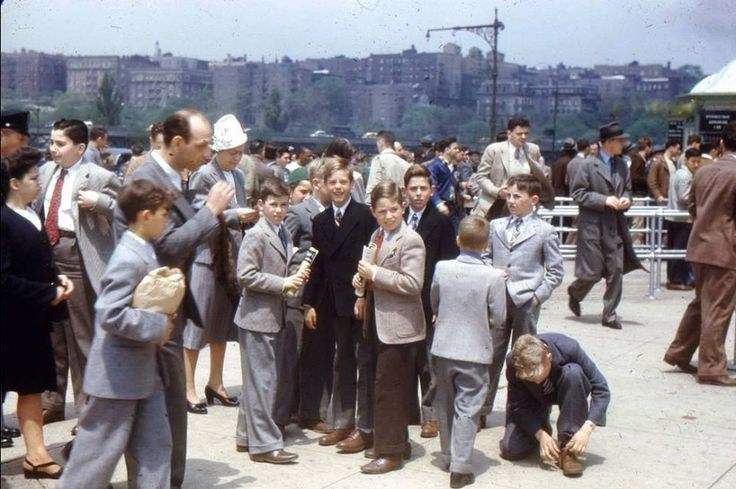 """Hector HeresiOld Images of New York Group  Bronx 1947 in front of the Yankee Stadium.  One writer suggested this was a Jehovah's Witness convention, rather than a ball game.  Either way, it was a time of """"dressing up"""" - no baggy shorts and backwards baseball caps..."""
