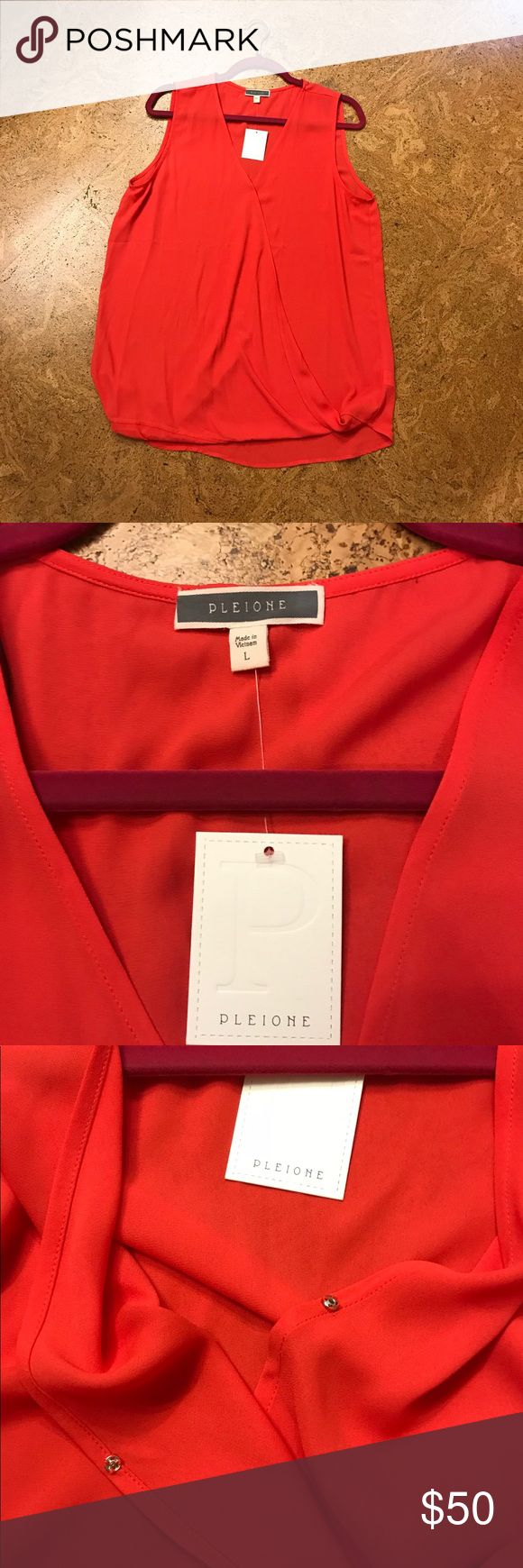 NWT Pleione Blouse Size L Beautiful coral color purchased at Nordstrom's The Rack. It's very flowy and loops at the bottom. One snap as pictured above to keep it closed. I also included a picture of where there is a spot at that snap I believe from me trying it on with pressed powder. Should come out no problem in the wash I didn't want to take the tags off of it. Feel free to ask me any questions or make an offer. Pleione Tops