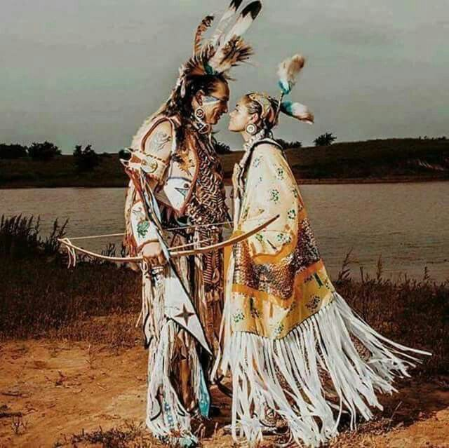 Unknown pair of Indians sharing affection. A young couple, family members, just a moment of quiet peace - the picture is not dated. They appear to be costumed for dancing.