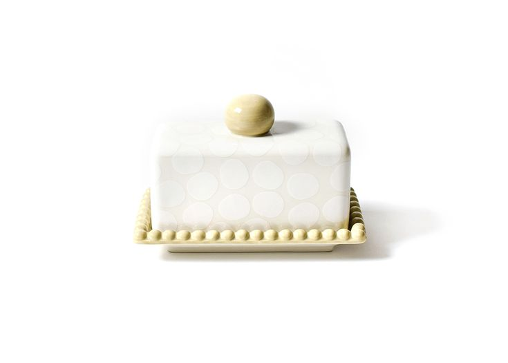 Serve and store your butter in style with our White Pebble Butter Dish! Designed with an elegant beaded detail and easy to handle knob accent, the grand scale and sophisticated, subtle palette combine form and function. Pair with our White Pebble Sauce Pitcher for versatile table service that compliments classic and contemporary decor alike.