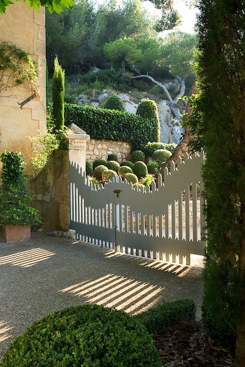 gate leading to country garden in provence photo by clive nichols for garden design magazine