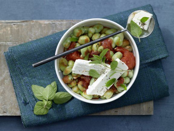 This light stew is made with beans and tomatoes then topped with feta cheese for a vegetarian meal that is full of fresh flavors.   Eat Smarter