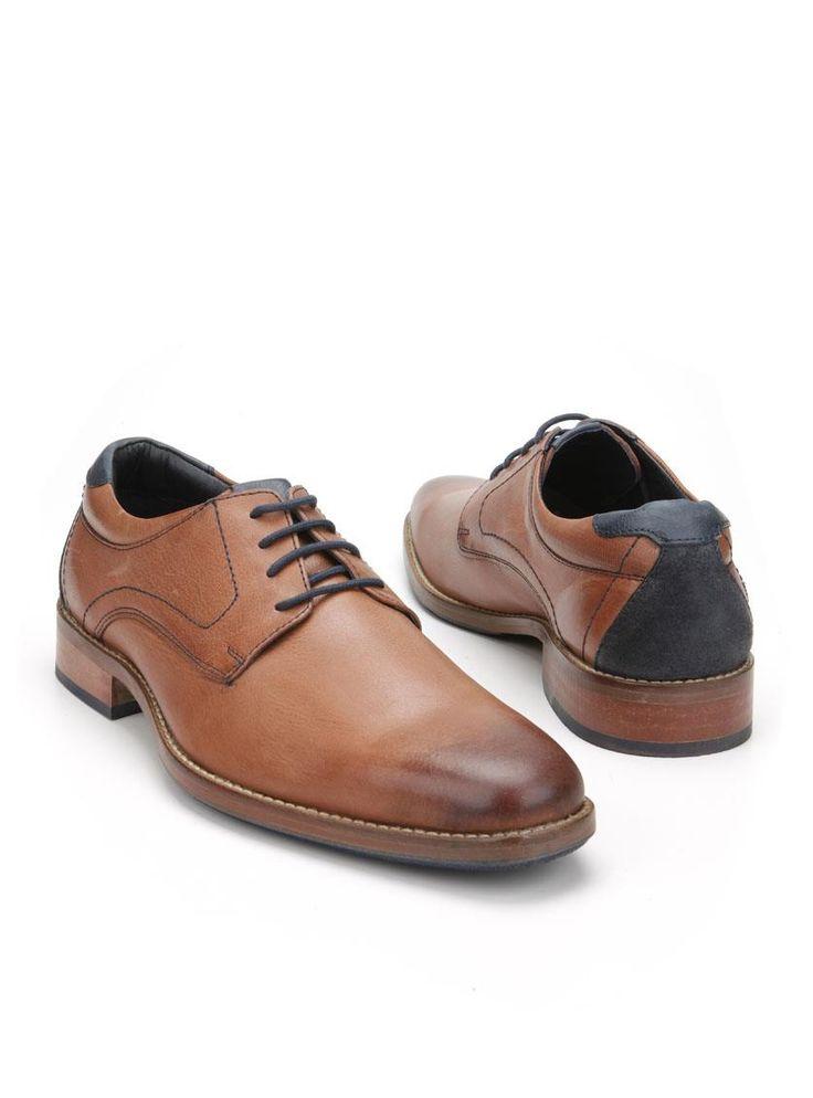 MOOY herenschoen  Description: MOOY geklede veterschoenen in het cognac. Deze herenschoenen hebben een bovenwerk gemaakt van leer en een kunststof zool. De schoenen zijn voorzien van blauwe details.  Price: 62.99  Meer informatie