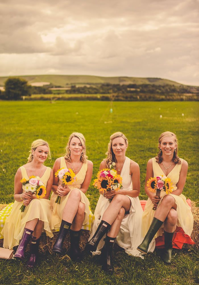 These pale yellow bridesmaids dresses are PERFECT for a relaxed, outdoor summer wedding! Throw in a sunflower bouquet and wellington boots, and you're guaranteed a wedding full of fun ideas!