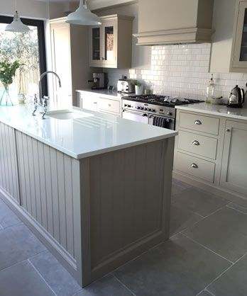 Paris Grey tumbled limestone kitchen floor tiles. Our stone tile works well with any colour palette. Light to medium grey- blue in tone which was used both inside and outside. http://www.naturalstoneconsulting.co.uk/limestone-paris-grey-limestone