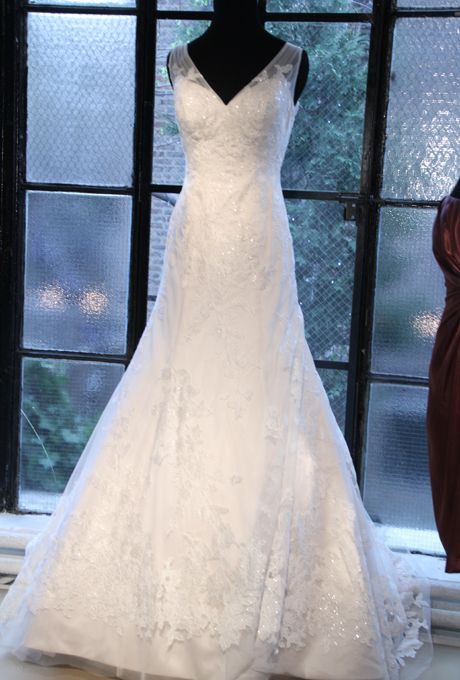 Brides: David's Bridal - Fall 2012. Sleeveless beaded lace and tulle A-line wedding dress with illusion v-neck staps, David's Bridal