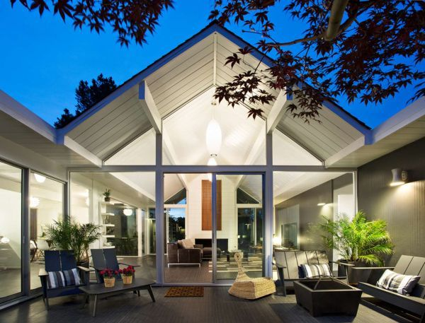Double Gable Eichler Remodel - Outdoor Area - The original Eichler was remodeled by Klopf Architects in 2014 and fitted with mid-century furniture. The key Eichler house concepts of maintaining the strong indoor-outdoor connection were retained.