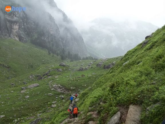 Hampta Pass, The First Himalayan Trek Of My Life  >>> We strap our backpack, and get ready to start our trek. I can feel the excitement getting built within me as the trek is above to start. We cover everything since it is raining. There is a tea stall that provides last minute supply before starting the trek.  >>>>   #HamptaPass, #ChandratalLake, #HimalayanTrek, T#rekking, #Camping, #AdventureTrips, #India, #365hops