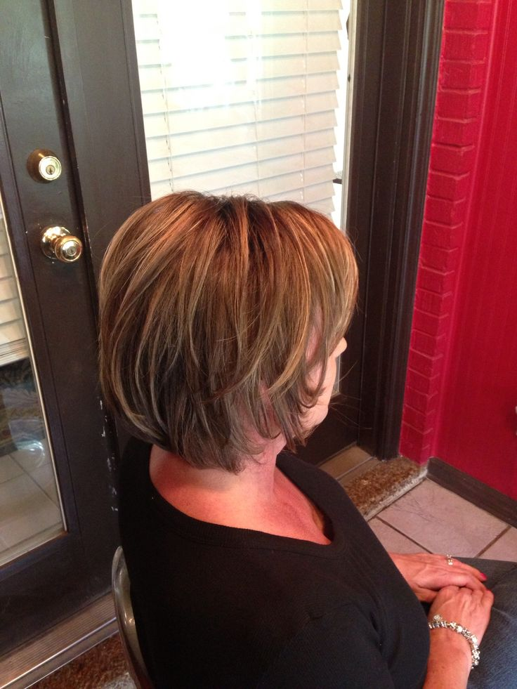 Rich brunette hair color with pecan and honey highlights. Medium length layered bob.