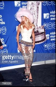 Pamela Anderson poses for a picture at the MTV Video Music Awards September 9 1999 in New York City Anderson got her start in Labatt's beer...