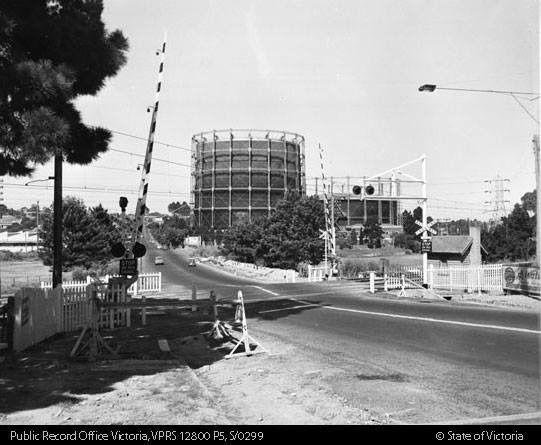 1950s Toorak Road boom gates. Looking towards Tooronga Gasometer.