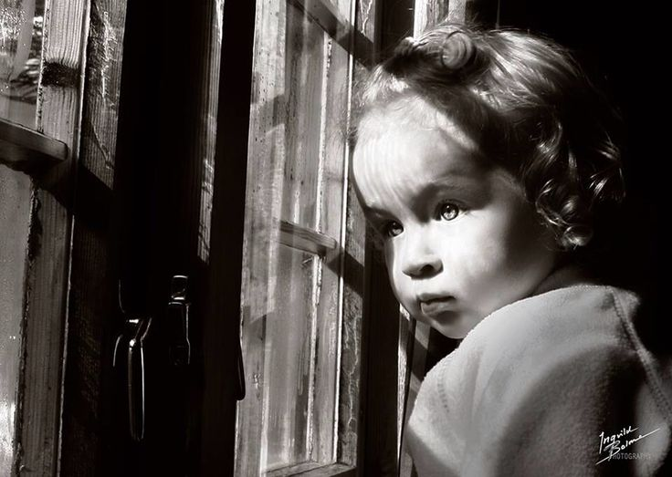 My daughter 17 months old, looking out trough the cottage window. The snow outside is magic. © Ingvild Bolme Photography