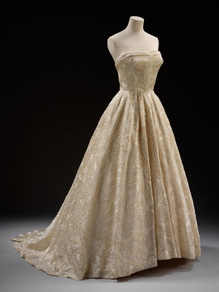 Evening dress by Givenchy  Evening dress 'Les Muguets' (Lilies of the Valley) Designed by Hubert de Givenchy (born 1927) Paris, France 1955 Silk organdie embroidered with white silk and sequins Museum no. T.223-1974 Given by the Viscountesss de Bonchamps