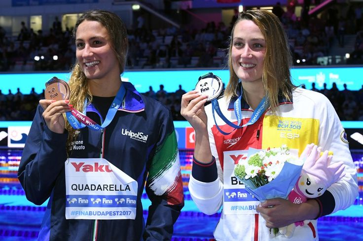 (L-R) Italy's Simona Quadarella and Spain's Mireia Belmonte celebrate on the podium after the women's 1500m freestyle final during the swimming competition at the 2017 FINA World Championships in Budapest, on July 25, 2017.  / AFP PHOTO / ATTILA KISBENEDEK