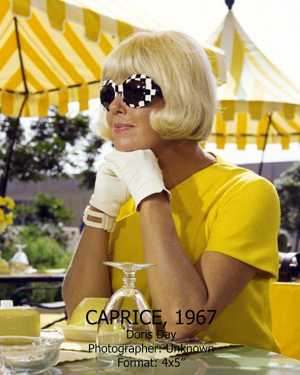Doris Day from the film Caprice, 1967, with giant mod suglasses. This yellow and black and white outfit was surely part of the basis for 2003's memorable-yet-underappreciated, Doris & Rock-inspired film, Down With Love -- yellow and black and white coats with linings scene, anyone?