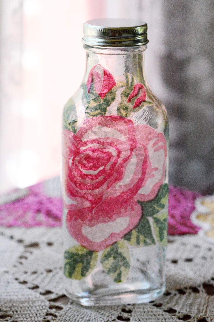 Floral water decals are hard to find these days but napkins do the trick at a thrifty price!    Just brush a thin layer of modge podge over the glass first, then attach your cut out design and modge podge over it.