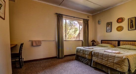 1 of 3 Bedrooms in the 6 bed cottage at Thendele Camp, uKahlamba Drakensberg Park located in KwaZulu-Natal
