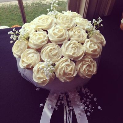 Bridal Bouquet Cupcake  bouquet. Though this bridal bouquet looks deceptively real, it's just cupcakes.  Each cupcake is creatively arranged to resemble the flowers in the bride's bouquet complete with baby's breath and ribbons--adorably perfect for a bridal shower.