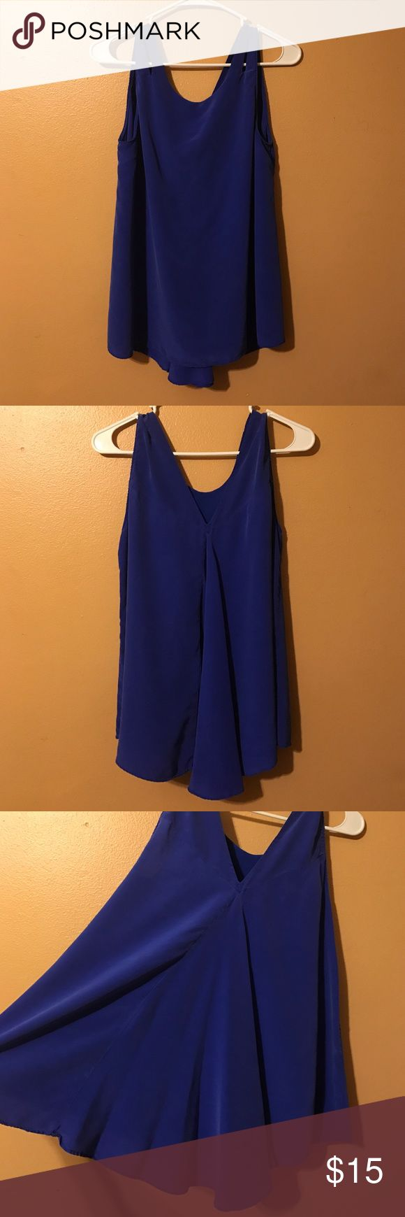 Royal blue blouse Royal blue blouse in size medium. The front is a higher fit and the back comes down in a V below the shoulder blades. Very very soft material and double lined (shear material on the inside) it fits a little tighter under the arms on me, so it would definitely fit a woman with smaller arms. No discoloration or rips. The straps on the shoulders are two separate pieces but are sewed together (pictured). 100% silk and the inside is 100% polyester. charlie jade Tops Blouses